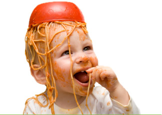 Baby covered in spaghetti