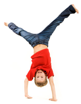Boy performing a hand stand